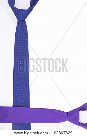 Two tie in shades of purple on a white background. Top view