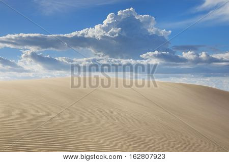 Mui Ne white sand dunes on the background of blue sky. Southeast Asia Vietnam