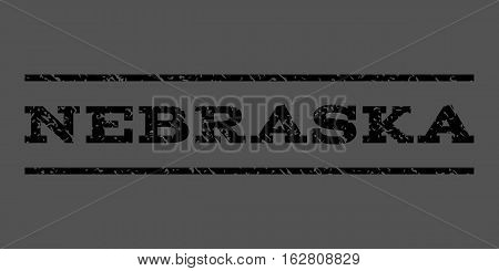 Nebraska watermark stamp. Text caption between horizontal parallel lines with grunge design style. Rubber seal stamp with unclean texture. Vector black color ink imprint on a gray background.
