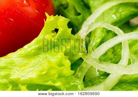 Cherry In A Salad With Lettuce Leaves, Olive Oil And Onions