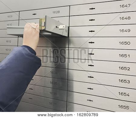 Safe deposit box open in a sure safe deposit cell