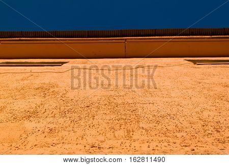 Wall, wall fragment, fragment of wall, yellow wall, ocher wall. Abstract fragment of wall.
