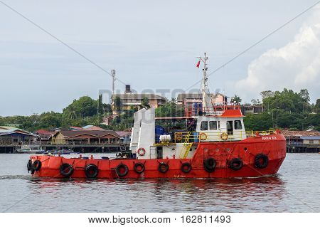 Labuan,Malaysia-Dec 23,2016:Vessel named as Ramai 103 is tug boat in Labuan island,Malaysia on 23rd Dec 2016.Labuan shipping activity is one of the approved Labuan business activity under LBATA 1990.