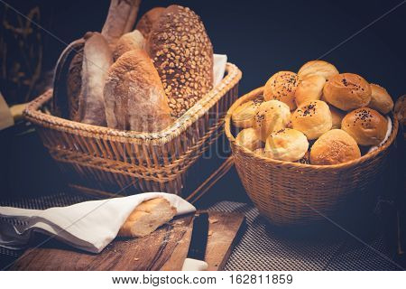 Buns with sesame seeds and different kinds of bread