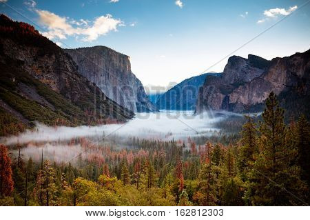 The iconic view of Yosemite Valley and the magnificent El Capitan at sunrise from Tunnel View in California, USA