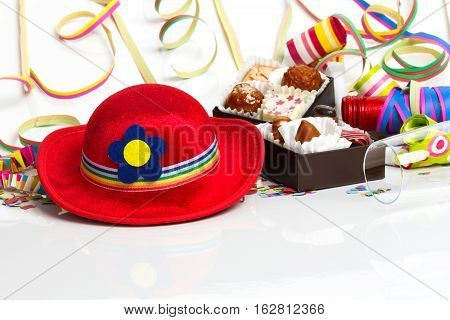 Carnival decoration New Year's Eve decoration with a hat and pralines
