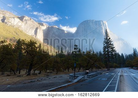 The view from Southside Drive of El Capitan rock face at sunrise in the fog in California, USA