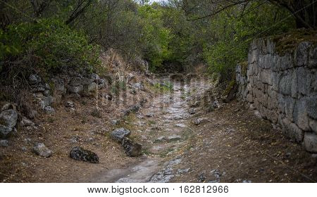 The road to Chufut-Kale - medieval cave town in Crimean Mountain. Bakhchisarai.