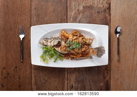 Fried Seabass with garlicReady to eat. On The Table