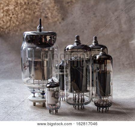 vertical composition of vacuum tubes on kraft paper. vintage electronic background
