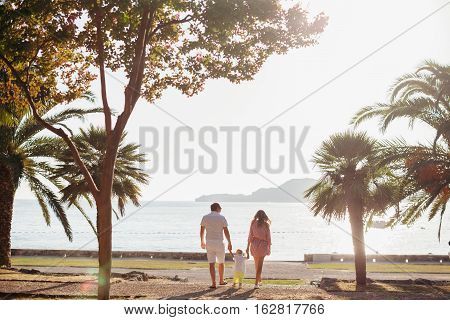 Unidentified Family Vacation On Luxury Beach