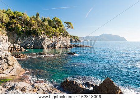 Rocky coastline near Genoa during a sunny winter morning