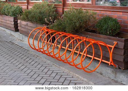 Good parking for bicycles. Spiral orange bike stand in Kiev, Ukraine