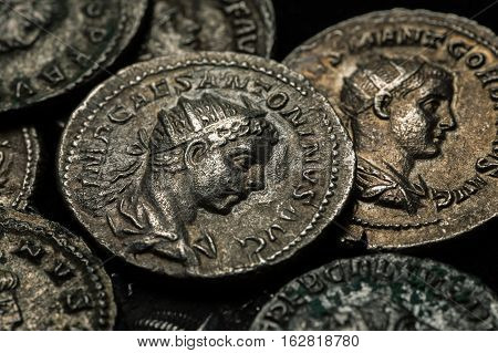 Pile Of Ancient Silver Coins With Portraits