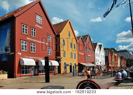 Bergen Norway - July 20 2014: Color buildings along the bay. Bergen is a row of old Hanseatic commercial buildings and a UNESCO World Heritage site.