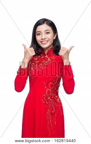 Smile Vietnamese Woman In Dress Traditional Ao Dai And Introduce On White Background.