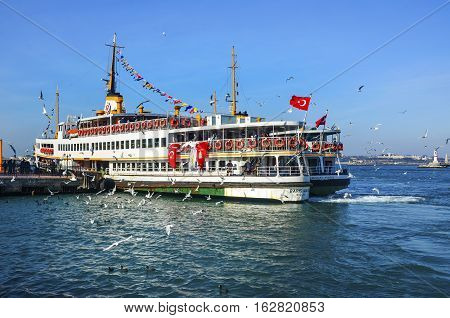Istanbul Turkey - February 2 2014: Old Kadıkoy Ferry Pier and Istanbul Ferries (called vapur in Turkish) continue to serve as a key public transport link for many Thousands of commuters tourists and vehicles per day.
