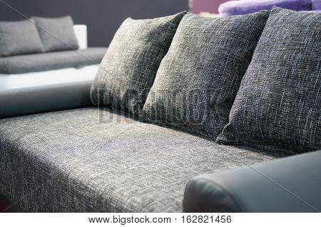 Confortable gray sofa, color image, horizontal image