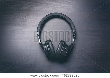 Headphones on a dark background. Music accessories. Bluetooth headphones without cable.