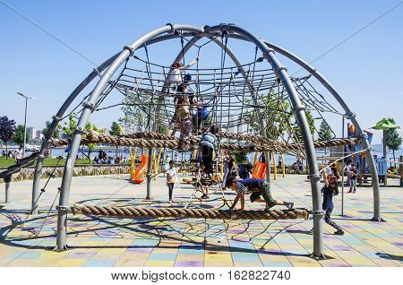 Istanbul Turkey - May 29 2016: Public Children playground Istanbul Kadikoy district beach. Combination playground structure for small children; slides climbers (stairs in this case) playground.
