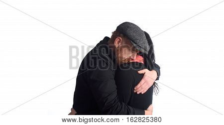 Middel age Couple embracing on a white background
