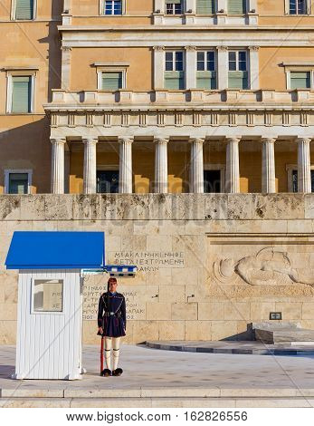 ATHENS, GREECE - DECEMBER 9: Evzone guard in front of the tomb of the Unknown soldier on December 9, 2016 in Athens. Their uniforms are based on traditional 19th century costume from southern Greece.