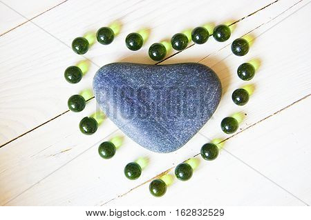 Heart made of natural stone and glass beads
