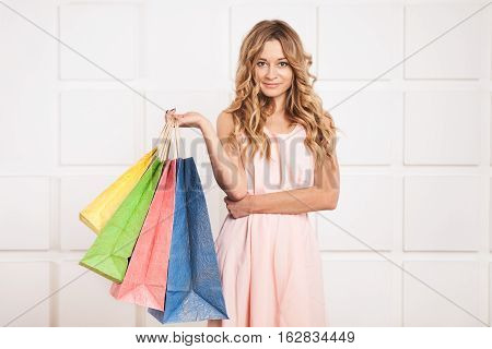 Beautiful woman with a shopping bags. Portrait of young happy smiling woman with shopping bags