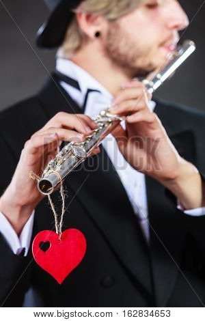 Male Flutist With Flute And Heart. Love Melody