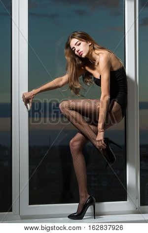 Fashionable Sexy Girl At Window