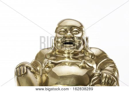 Traditional Brass Buddha figure against white background. The laughing monk brass figure with happy smiling expression.