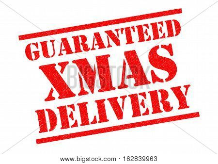 GUARANTEED XMAS DELIVERY red Rubber Stamp over a white background.