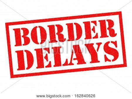 BORDER DELAYS red rubber Stamp over a white background.