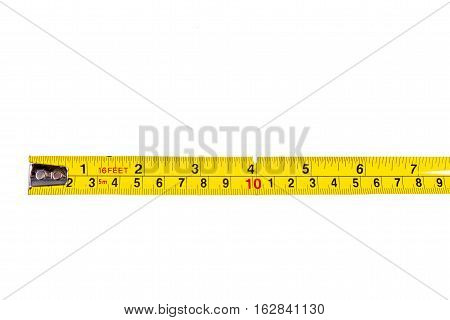 A close-up shot of a tape measure ruler over a white background.