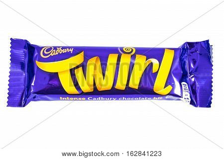 LONDON UK - OCTOBER 13TH 2016: An unopened Twirl chocolate bar manufactured by Cadbury pictured over a plain white background on 13th October 2016.