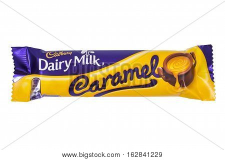 LONDON UK - OCTOBER 13TH 2016: An unopened Dairy Milk Caramel chocolate bar manufactured by Cadbury pictured over a plain white background on 13th October 2016.