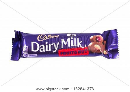 LONDON UK - OCTOBER 13TH 2016: An unopened Dairy Milk Fruit and Nut chocolate bar manufactured by Cadbury pictured over a plain white background on 13th October 2016.