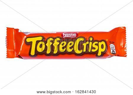 LONDON UK - OCTOBER 13TH 2016: An unopened Toffee Crisp chocolate bar manufactured by Nestle pictured over a plain white background on 13th October 2016.