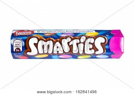LONDON UK - OCTOBER 13TH 2016: An unopened Smarties chocolate sweets tube manufactured by Nestle pictured over a plain white background on 13th October 2016.