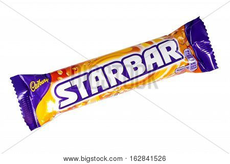 LONDON UK - OCTOBER 13TH 2016: An unopened Starbar chocolate bar manufactured by Cadbury pictured over a plain white background on 13th October 2016.