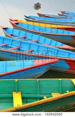POKHARA, NEPAL: Colorful rowing boats on the Phewa Lake