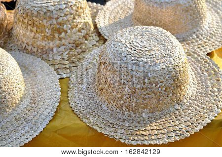 close-up of traditional ukrainian straw hats for sale