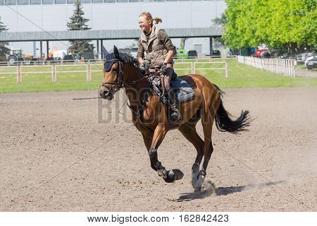 Kiev Ukraine - June 09 2016: Girl on a horse trained in show jumping
