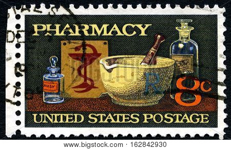 UNITED STATES OF AMERICA - CIRCA 1972: A stamp printed in America shows image of typical items in a pharmacy mortar and pestle bowl of Hygeia circa 1972.