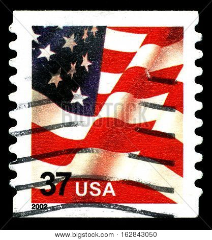 UNITED STATES OF AMERICA - CIRCA 2002: A used postage stamp from the United States of America featuring an illustration of the Stars and Stripes of the American flag circa 2002.