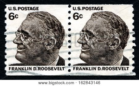 UNITED STATES OF AMERICA - CIRCA 1966: A used postage stamp from the USA depciting an illustration of Franklin D Roosevelt - the 32nd President of the United States circa 1966.