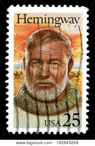 UNITED STATES CIRCA 1989: A used United States Postage Stamp depicting an image of American author and Journalist Ernest Hemmingway circa 1989.