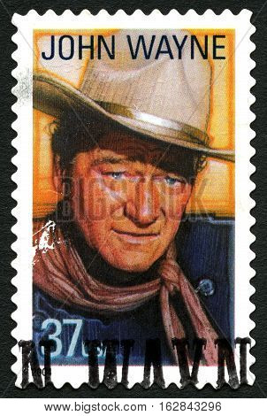 UNITED STATES OF AMERICA - CIRCA 2004: A used postage stamp from the USA depicting an image of legendary actor John Wayne circa 2004.