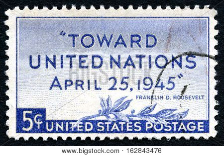 UNITED STATES OF AMERICA - CIRCA 1945: A used postage stamp from the USA celebrating the formation of the United Nations and featuring a quote from President F.D. Roosevelt circa 1945.