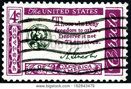 UNITED STATES OF AMERICA - CIRCA 1960: A used postage stamp from the USA depicting a quote by President Lincoln promoting freedom circa 1960.